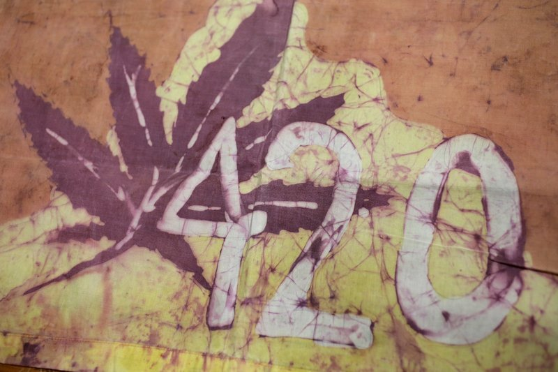 This Friday, April 13, 2018, photo, shows a Waldos 420 flag from 1972 made by a classmate at San Rafael High School, at a bank vault in San Francisco. Friday is April 20, or 4/20. That's the numerical code for marijuana's high holiday