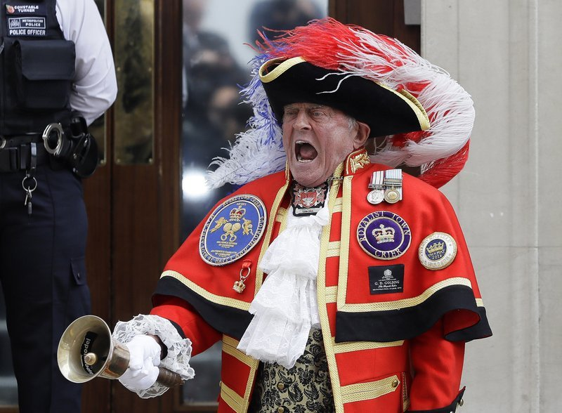 Town Crier Tony Appleton announces that the Duchess of Cambridge has given birth to a baby boy outside the Lindo wing at St Mary's Hospital in London, Monday, April 23, 2018. (AP Photo)