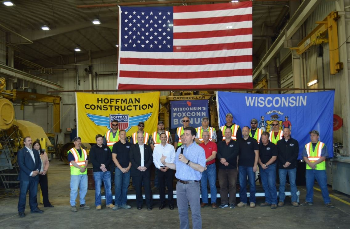 In this photo from at tweet from Gov. Scott Walker , the governor announces that Hoffman Construction of Black River Falls is taking part in the development of the Foxconn site.
