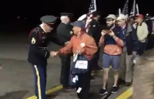 Veterans are greeted as they return to La Crosse after spending the day in Washington, D.C.