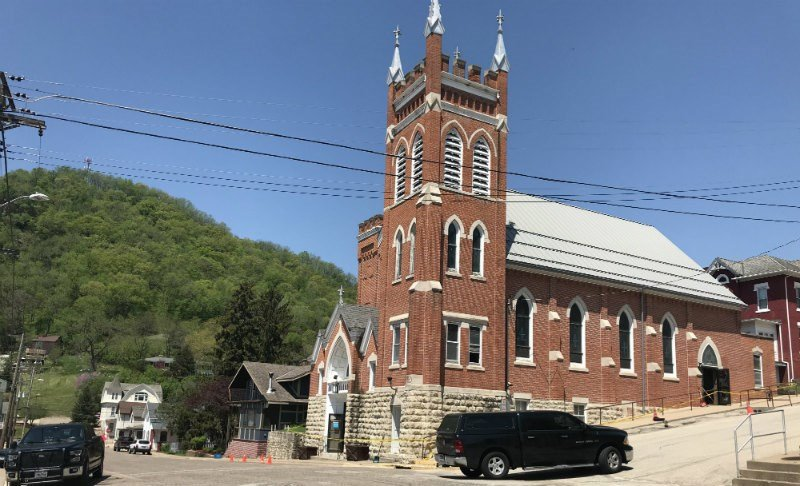 Caution tape surrounds St. Mary's Immaculate Conception Catholic Church in Fountain City following a fire Wednesday morning. The cause of the fire is under investigation.