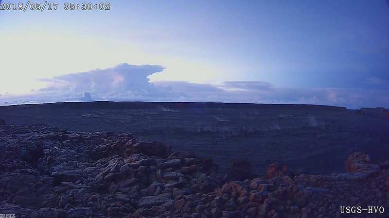 This photo provided by U.S. Geological Survey shows the ash plume at the Kilauea Volcano, taken from a Mauna Loa webcam on Thursday, May 17, 2018. The volcano erupted from its summit, shooting a dusty plume of ash about 30,000 feet into the air.