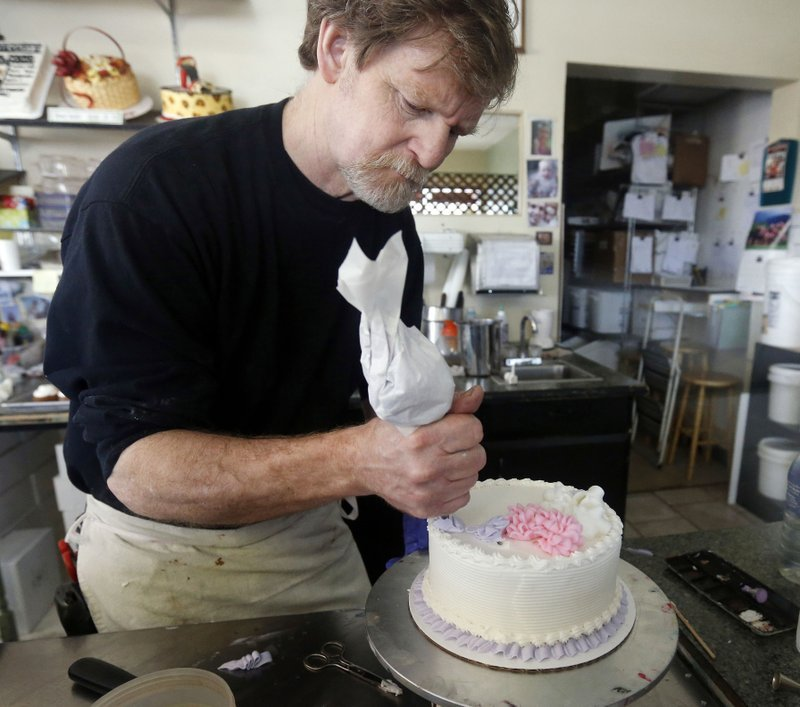 In this March 10, 2014, file photo, Masterpiece Cakeshop owner Jack Phillips decorates a cake inside his store in Lakewood, Colo.  (AP Photo/Brennan Linsley, File)