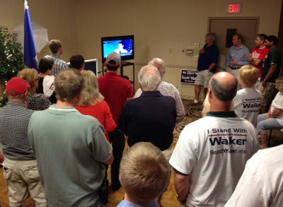 La Crosse area Republicans watch Gov. Scott Walker's victory speech Tuesday.