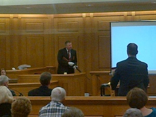 Sgt. John Zimmerman shows the jury the .22 rifle found in the Koula home