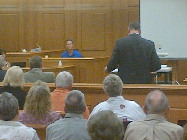 Neighbor Michael Lenz testifying about the events on May 21, 2010, the day of the murders.