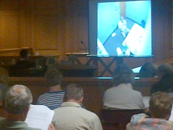 Jurors and the gallery watch an interview with Eric Koula done by investigators.