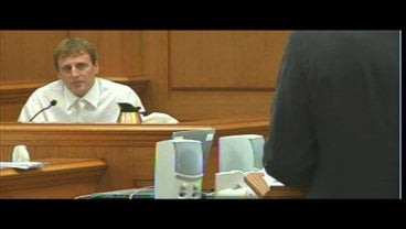 Eric Koula testifying in his homicide trial as prosecutors question him about the deaths of his parents.