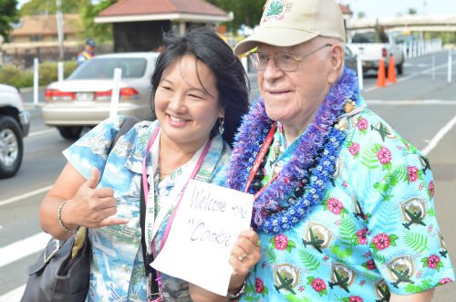 """Ewald """"Cookie"""" Koch and Jessie Higa at the entrance to Hickam Field"""