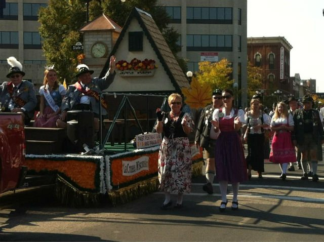 Members of Oktoberfest march and ride in the parade Friday morning