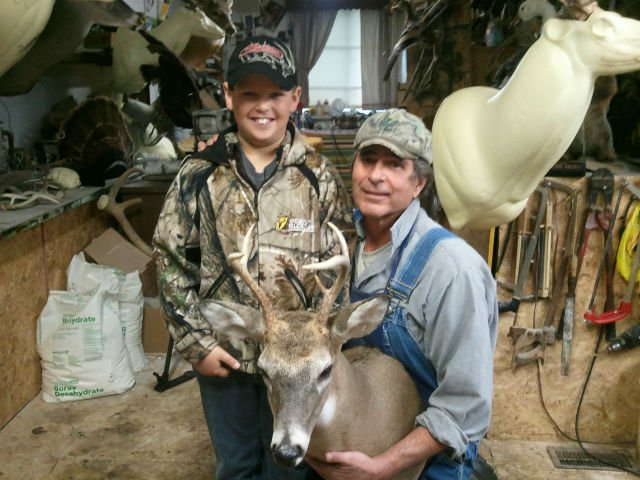 Colton Flock and Jerry Shepard with the 3000th deer mount