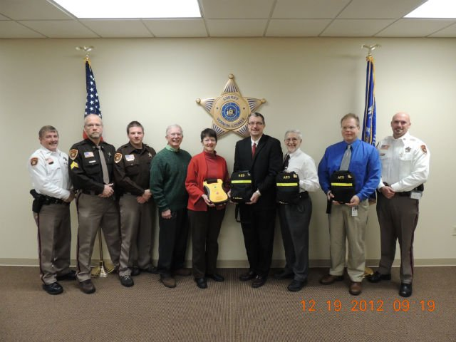 Vernon County Sheriff John B. Spears, Sergeant Charlie Jacobson, Deputy Greg Lawton, Chuck Stelzner, Kathie Stelzner, Kyle Bakkum (CEO-Vernon Memorial Healthcare), Jim Klock (Administrative Director of Emergency Services-Gundersen Lutheran), Tom Tornstrom