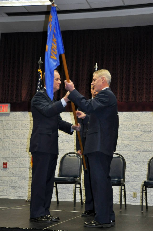 Col. David Romuald receives the flag of command from Maj. Gen. Don Dunbar, adjutant general of Wisconsin.     Photo courtesy Wisconsin National Guard Public Affairs Office