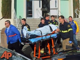 This image shows paramedics transporting a student wounded during a shooting Thursday Jan. 10, 2013 at San Joaquin Valley high school in Taft, Calif. (AP Photo/Taft Midway Driller, Doug Keeler)