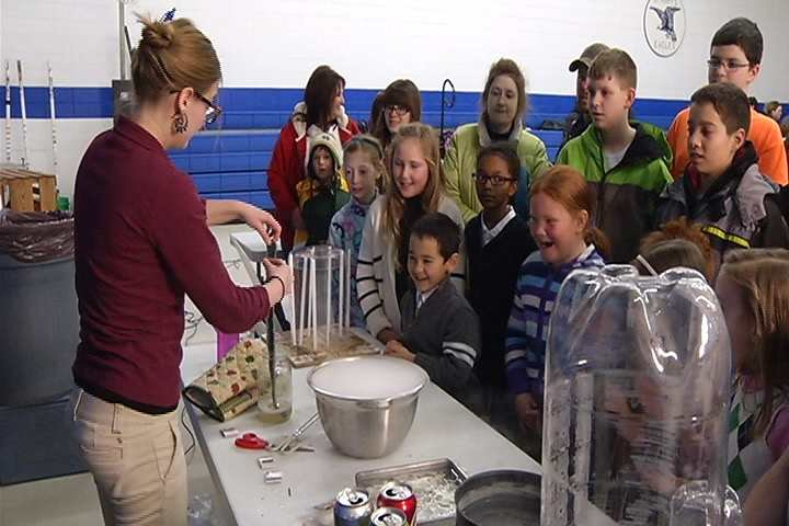 Madeline Sky showing parents and students at St. Mary's one of the science experiments they do during the News 19 Weather Academy.