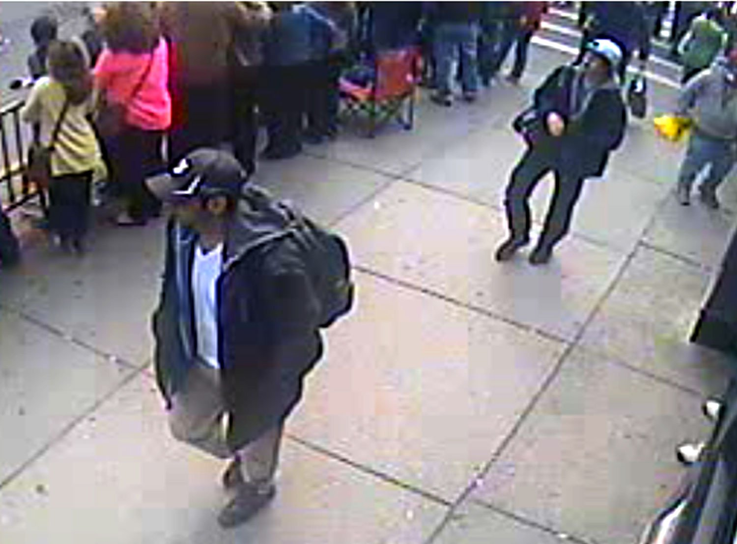 FBI released photo of the two individuals, identified as Suspect 1 and Suspect 2, wanted for questioning in the Boston bombings.