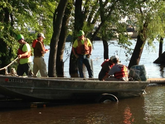 Rescuers launch a boat below Lock and Dam Number 7 Wednesday morning.
