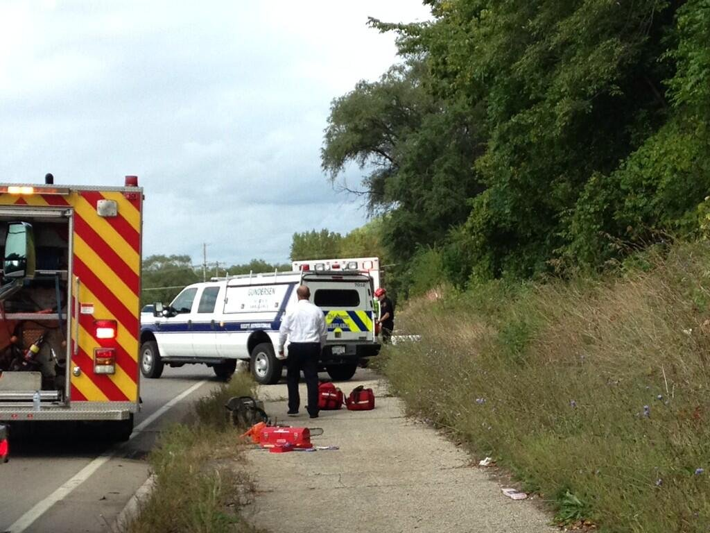 Rescue crews load bluff fall victim into ambulance along Hwy. 16 around 3:10 p.m.