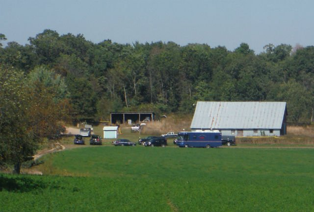 Authorities remain at the Helgeson farm Thursday afternoon.