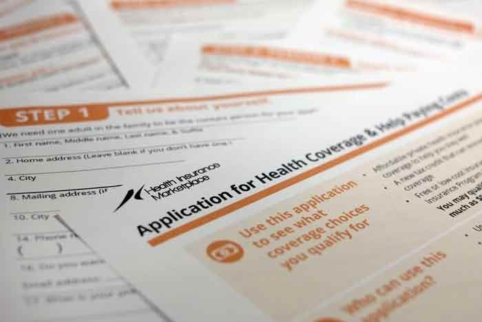 The federal government form for applying for health coverage is photographed in Washington. (AP Photo/J. David Ake)