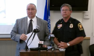 Monroe County District Attorney Dan Cary, left, with Tomah Police Chief Wes Revels, during news conference in the Vance Evans/Tammy Cole case in 2010.