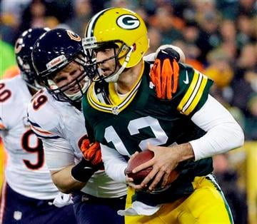 (AP Photo/Morry Gash). Green Bay Packers quarterback Aaron Rodgers is sacked by Chicago Bears' Shea McClellin during the first half of an NFL football game Monday, Nov. 4, 2013, in Green Bay, Wis.