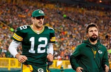 (AP Photo/Jeffrey Phelps). Green Bay Packers' Aaron Rodgers heads to the locker room after being hurt during the first half of an NFL football game against the Chicago Bears Monday, Nov. 4, 2013, in Green Bay, Wis.