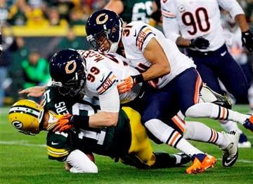 (AP Photo/Morry Gash). Green Bay Packers quarterback Aaron Rodgers is sacked by Chicago Bears' Shea McClellin (99) and Isaiah Frey (31) during the first half of an NFL football game Monday, Nov. 4, 2013, in Green Bay, Wis.