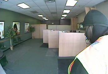 Surveillance pictures of the armed robbery suspect