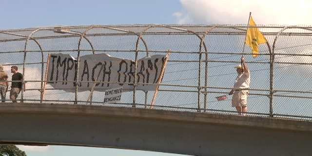 Protesters on the I-90 pedestrian overpass in August, 2013