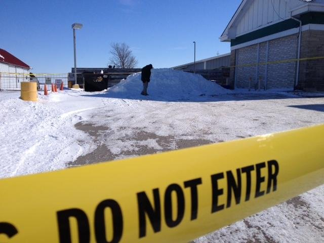 Investigators search area around gas station.
