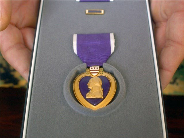 An example of the type of Purple Heart medal given to girl.