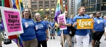 (AP Photo/Charles Rex Arbogast). Supporters of gay marriage in Wisconsin and Indiana attend a rally at the federal plaza Monday, Aug. 25, 2014, in Chicago.