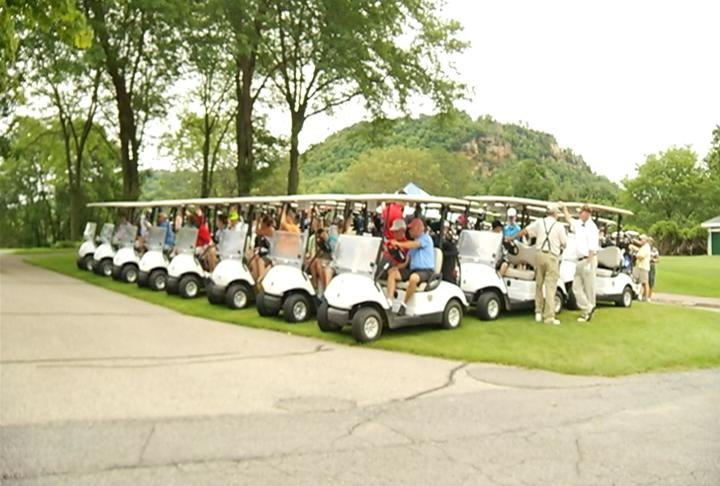 Over 80 golfers wait for the event to start.