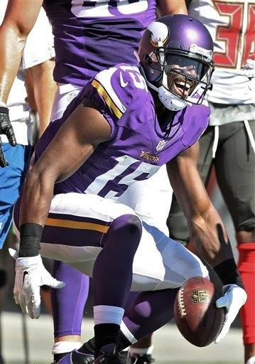 (AP Photo/Reinhold Matay). Minnesota Vikings wide receiver Greg Jennings (15) reacts after scoring a touchdown against the Tampa Bay Buccaneers during the third quarter of an NFL football game Sunday, Oct. 26, 2014, in Tampa, Fla.