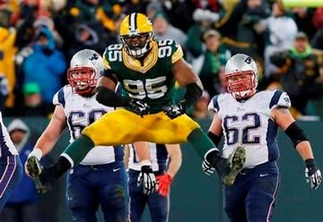 (AP Photo/Mike Roemer). New England Patriots' Bryan Stork (66) and Ryan Wendell Wduring watch as Green Bay Packers' Datone Jones celebrates after Tom Brady was sacked the second half of an NFL football game Sunday, Nov. 30, 2014, in Green Bay, Wis.