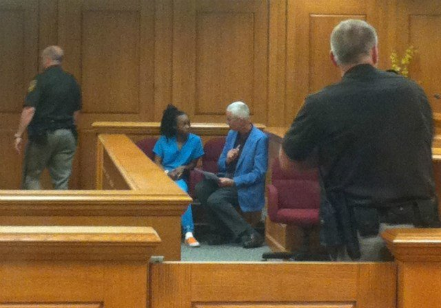 Brittany Jones speaks to her attorney prior to her initial court appearance in La Crosse County on June 5, 2013