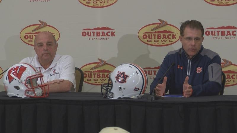 Wisconsin coach Barry Alvarez and Auburn coach Gus Malzahn answer questions from the media Monday in Tampa