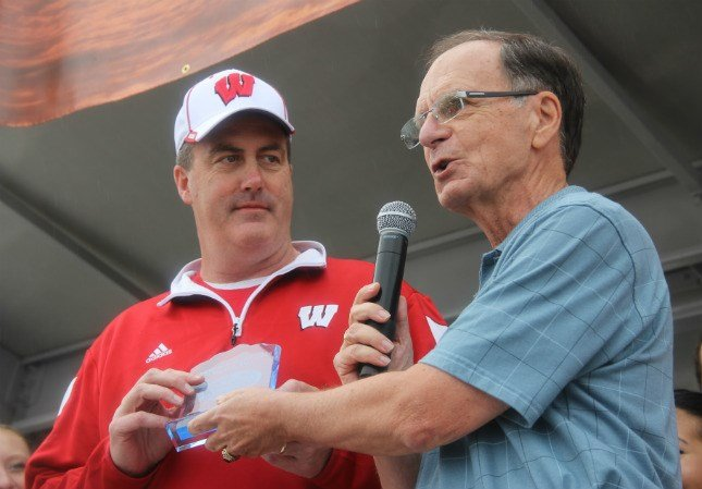 Wisconsin Head Football Coach Paul Chryst accepts an award to the team from Clearwater's mayor during Beach Day