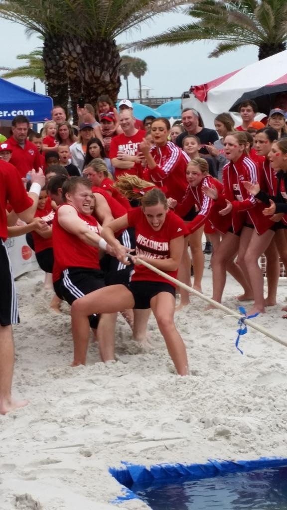 Tug-of-war competition at Beach Day, won by Wisconsin over Auburn
