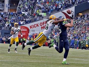Seattle Seahawks' Jermaine Kearse catches the game winning touchdown pass during overtime of the NFL football NFC Championship game against the Green Bay Packers Sunday, Jan. 18, 2015, in Seattle.