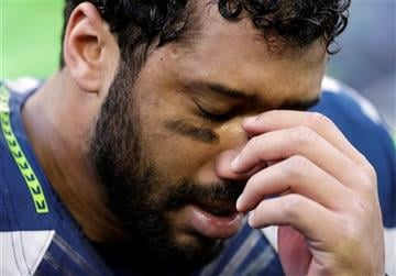 Seattle Seahawks' Russell Wilson reacts after overtime of the NFL football NFC Championship game against the Green Bay Packers Sunday, Jan. 18, 2015, in Seattle. The Seahawks won 28-22 to advance to Super Bowl XLIX.