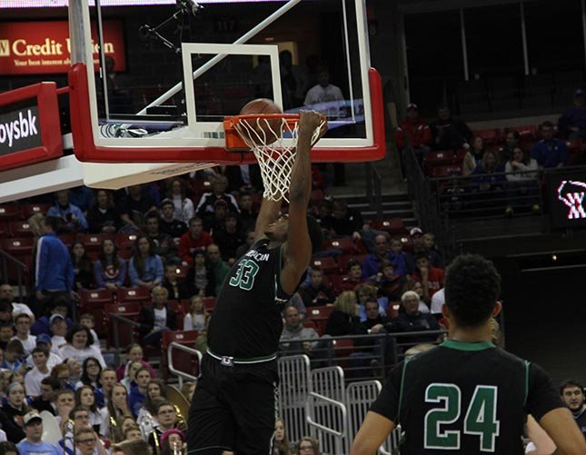 Diamond Stone with one of his slam dunks against Regis. He had 33 points Thursday night.