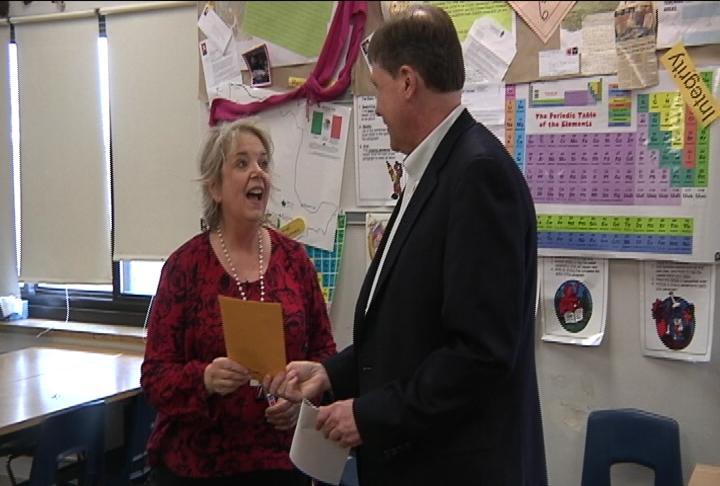 David Stoeffler surprises teacher Karen Wilke with a grant Monday
