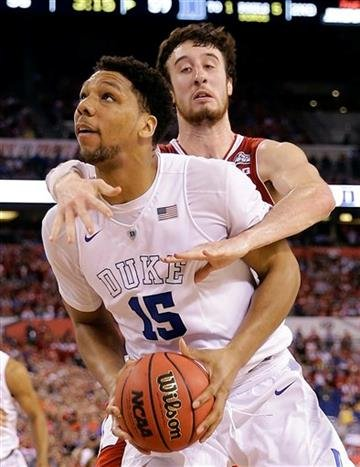 (AP Photo/David J. Phillip). Duke's Jahlil Okafor (15) is fouled by Wisconsin's Frank Kaminsky (44) during the second half of the NCAA Final Four college basketball tournament championship game Monday, April 6, 2015, in Indianapolis.