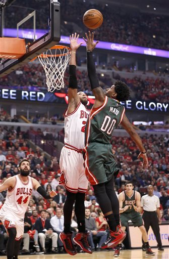 Milwaukee Bucks guard O.J. Mayo (00) shoots over Chicago Bulls forward Taj Gibson during the first half in Game 5 of the NBA basketball playoffs Monday, April 27, 2015, in Chicago.
