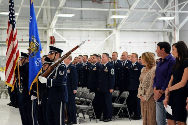 The115th Fighter Wing Honor Guard post the colors during Airman 1st Class Kelly C. Tomfohrde's memorial service May 3.  115th Fighter Wing photo by Tech. Sgt. Tiffany Black