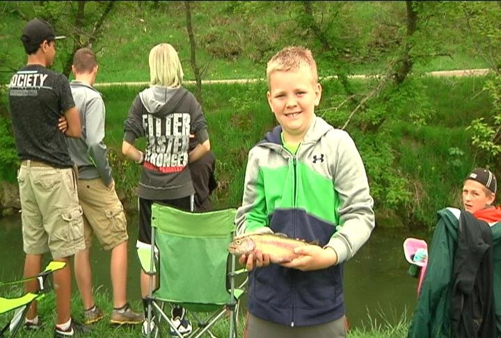 A boy holds up one of his catches at Saturday's Kids' Fishing Event, as part of Preston's Trout Days weekend.
