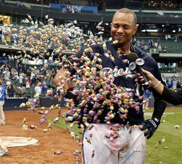 Milwaukee Brewers' Martin Maldonado is showered with bubble gum during a post game interview after their 7-6 victory against the Arizona Diamondbacks in a 17 inning baseball game, Sunday, May 31, 2015, in Milwaukee.