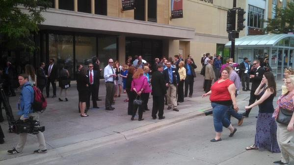 (Photo Greg Neumann/WKOW) People gathering across the street per Capitol Police order after bomb threat called into State Capitol